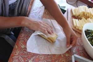 wrapping a tamale in parchment paper