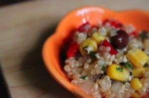 quinoa salad in a little orange dish
